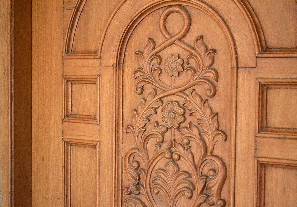 Carving doors vishwakarma timber mart for Door design in wood images